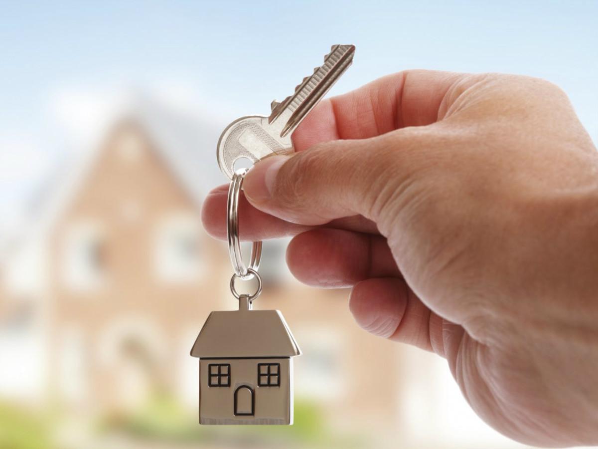 Holding a house key